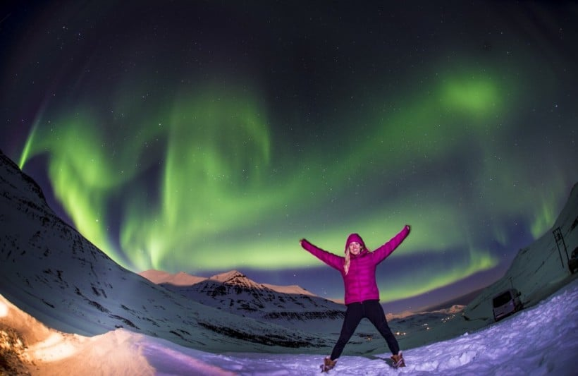 women watching northern lights